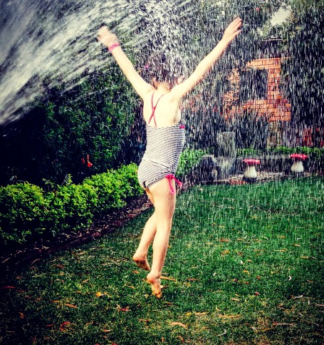 Under the sprinkler