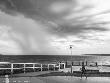 Storm cell and surfer, Bar Beach.